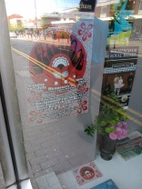 poster and flyers in a local shop window
